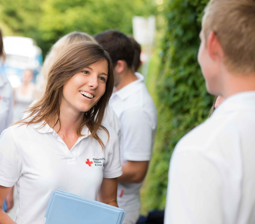 Kathrin im Job als Fundraiserin für das Bayrische Rote Kreuz